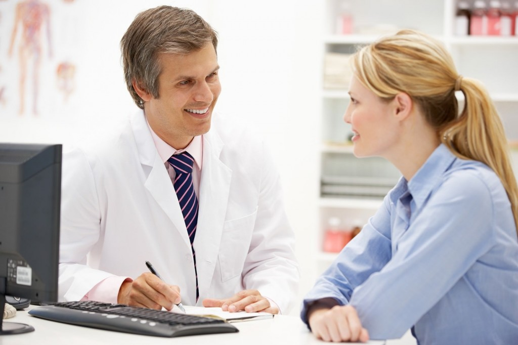 bigstock-Doctor-with-female-patient-24077858